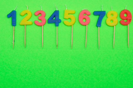 3 5 years: Birthday candles numbers 1 to 9 isolated on a green background