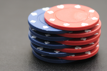 gamblers: Blue and red poker chips on a black background