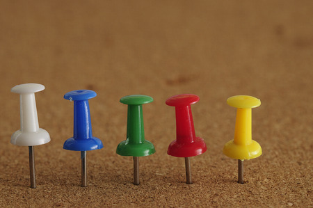 push in pins: Colorful push pins in a row Stock Photo