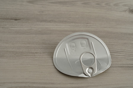 lid: A tin lid isolated on a wooden table Stock Photo