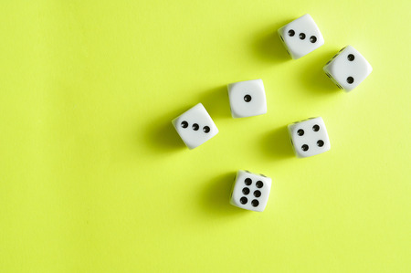 A collection of dices that has been rolled and landed on different numbers