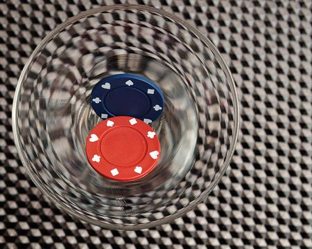 gambler: Poker chips in a Martini glass