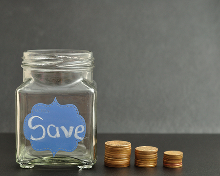 empty jar: An empty jar with the word save on it and coins stack next to it