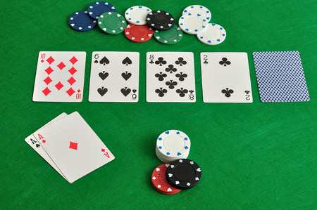 gambler: A poker table with cards and chips Stock Photo