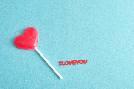 A heart shape lollipop with the words I love you