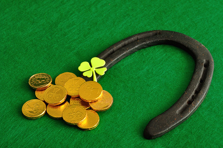 A shamrock, horse shoe and golden coins for St Patricks day