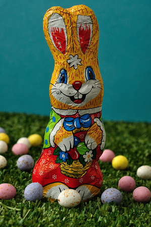 An easter bunny displayed with speckled easter eggs