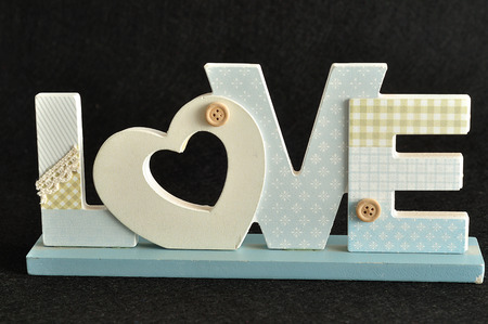 Valentines Day. Love in blue letters isolated on a black background