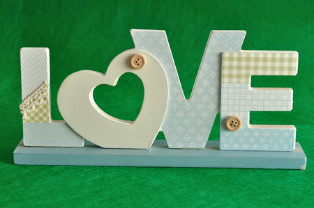 Valentines Day. Love in blue letters isolated on a green background