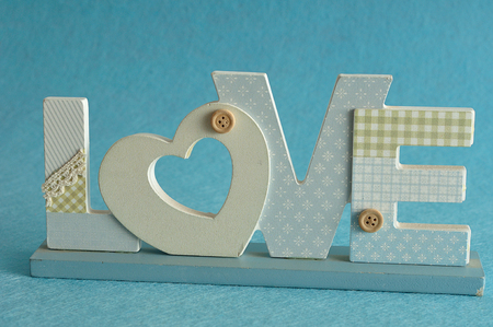Valentines Day. Love in blue letters isolated on a blue background
