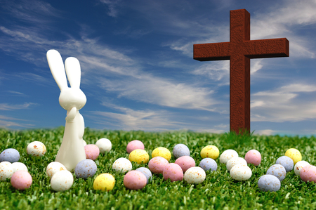 3D illustration. A white plastic bunny figurine displayed with speckled easter eggs and a wooden cross