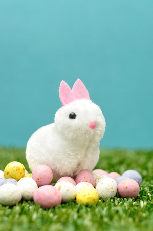 A fluffy bunny figurine with speckled easter eggs Stock Photo