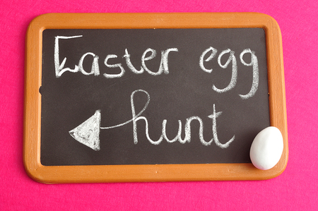 A blackboard with the words easter egg hunt and a white easter egg