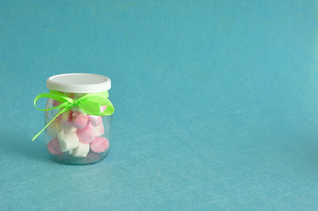 A jar filled with marshmallows