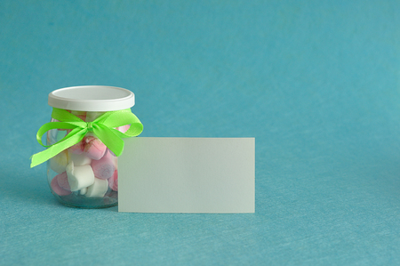 A jar filled with marshmallows and an empty card Stock Photo