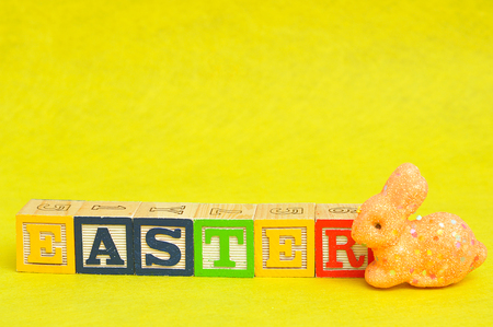 spelled: Easter spelled with alphabet blocks and an orange bunny