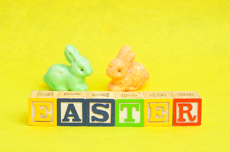 Easter spelled with alphabet blocks and a colorful bunnies