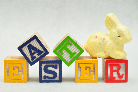 Easter spelled with alphabet blocks and a yellow bunny