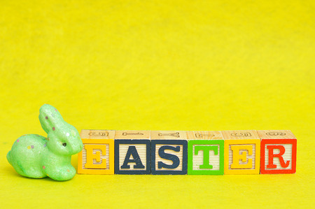 Easter spelled with alphabet blocks and a green bunny