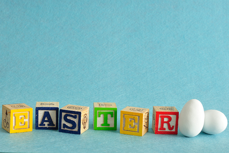 Easter spelled with alphabet blocks and a easter eggs