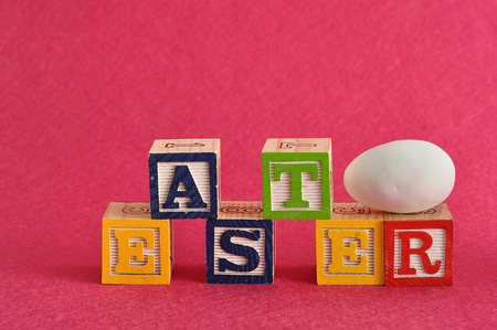 Easter spelled with alphabet blocks and a easter egg