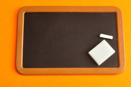 Blackboard, chalk and eraser