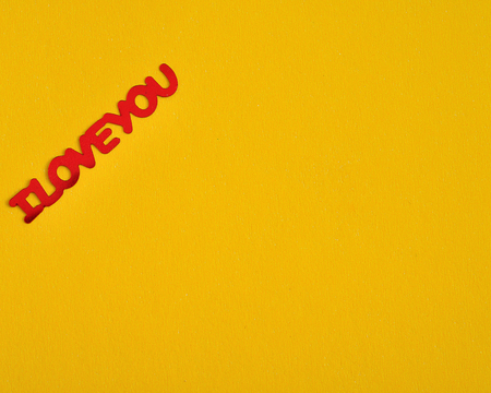 Valentine's Day. I Love You in red letters isolated on a yellow background Stock Photo - 92264673