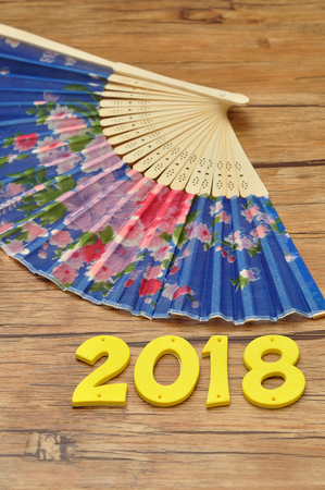 A blue hand fan with 2018 for the chinese new year Stock Photo