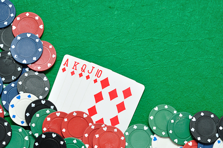 A royal flush displayed with poker chips Stock Photo