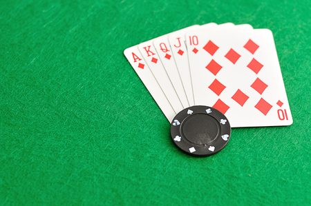 A poker chip with a royal flush that is out of focus Stock Photo