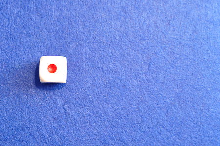 A single dice with the number one displayed on the top