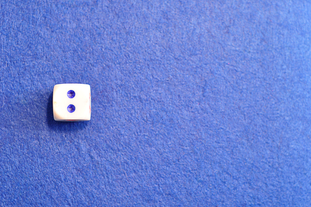 A single dice with the number two displayed on the top Stock Photo