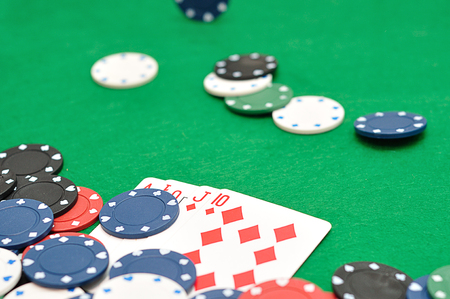 A royal flush displayed with poker chips. Shallow depth of field Stock Photo