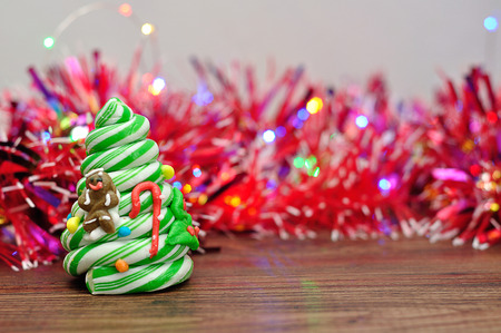 a candy cane christmas tree displayed with out of focus tinsel and lights stock photo - Candy Cane Christmas Tree