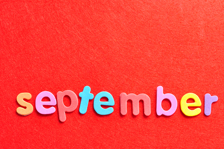 September on a red background 免版税图像