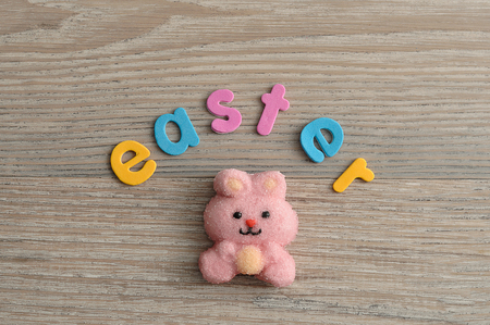 A pink bunny shape marshmallow with the word easter