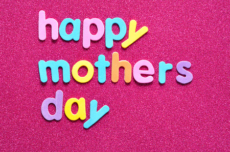 Happy mothers day on a pink background
