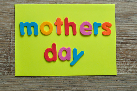 Mothers day on a yellow note