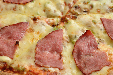 A full frame of a pizza with cheese and bacon Stock Photo