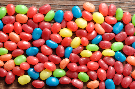 A variety of colors jelly beans on a wooden background Stock Photo