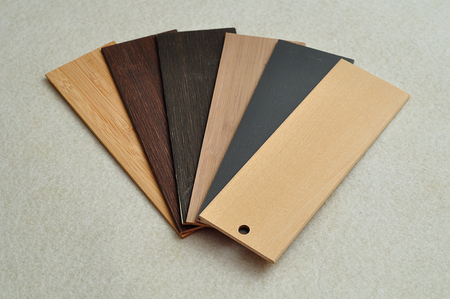 A swatch with different colors of wooden blinds