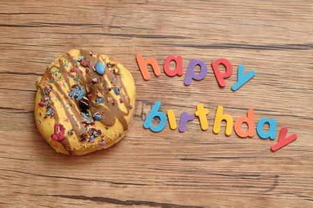 Happy birthday with a doughnut Stockfoto