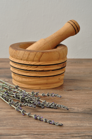 A bunch of lavender displayed with a wooden pestle Stock Photo