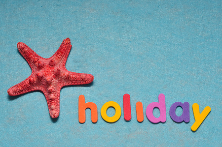 A starfish displayed with the word holiday