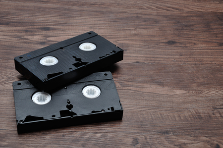 Video cassettes isolated on a wooden background