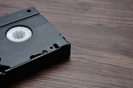 A video cassette isolated on a wooden background