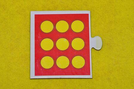 A jigsaw piece with nine dots