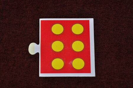 A jigsaw piece with six dots Stock Photo