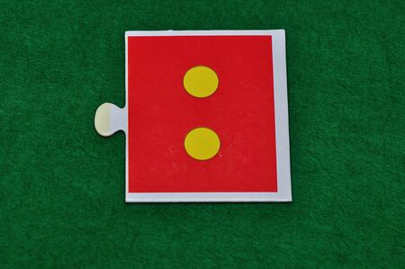 A jigsaw piece with two dots Stock Photo