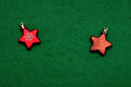Christmas tree decorations in the shape of a red stars Stock Photo
